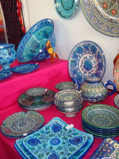I WANT THAT TEAPOT!  Blue ceramic from the village of Rishtan in Uzbekistan, the oldest center of ceramic art in Central Asia - at the Santa Fe International Folk Art Market