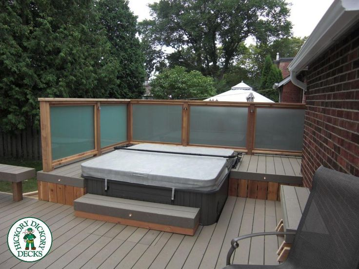 Kodiak Decking in Toronto. Built in Hot tub with frosted glass privacy. Cedar railing with 2x2 pickets 1x2 Cedar lattice privacy screen. lights in