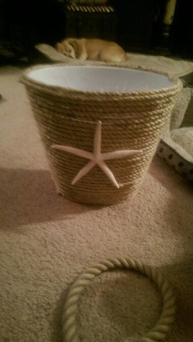 DIY nautical trash can. $2 for trash can, $4 for 1/2 in rope (100 ft). Bought supplies from Menards. Attach rope with hot glue and affix your choice of shells, starfish etc.  Compare to $30+ at Bed Bath and Beyond.