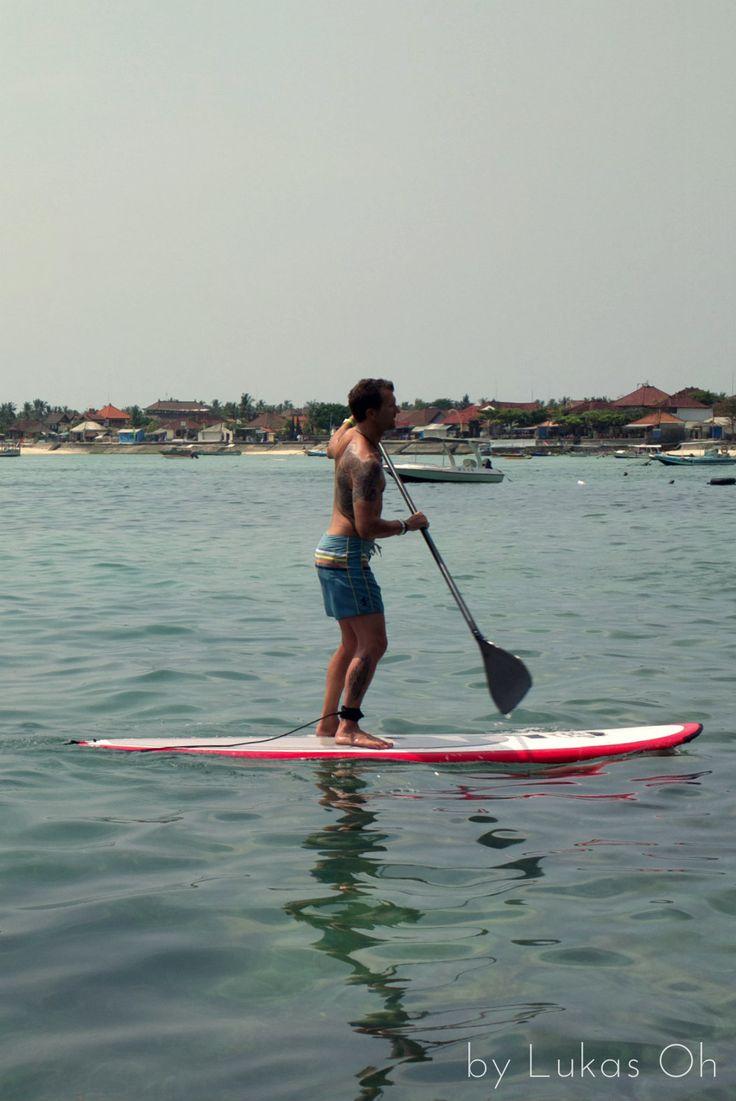 enjoying paddle surfing at Lembongan Island, Bali