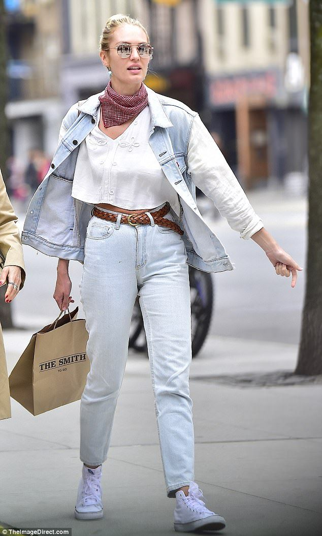Texas tuxedo: The South African stunner flaunted her post-baby waistline in a white crop-top, light blue mom jeans, a matching jean jacket, and white high-tops
