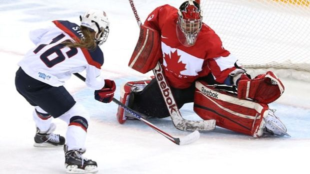 Canadian goalie Charline Labonté makes a stop against American Kelli Stack in the preliminary round in Sochi (Bruce Bennett/Getty Images)