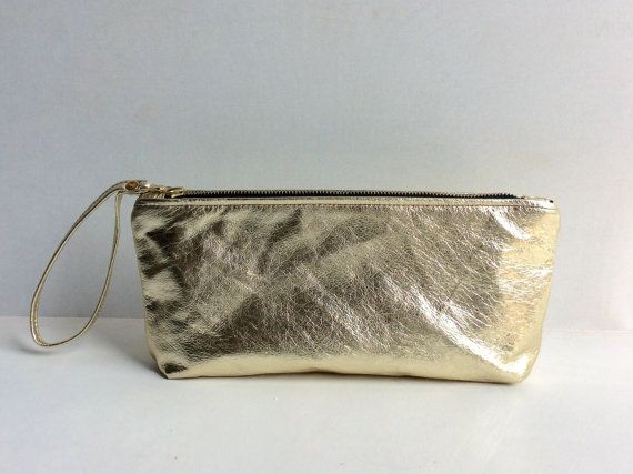 Hey, I found this really awesome Etsy listing at https://www.etsy.com/listing/228624081/gold-leather-clutch