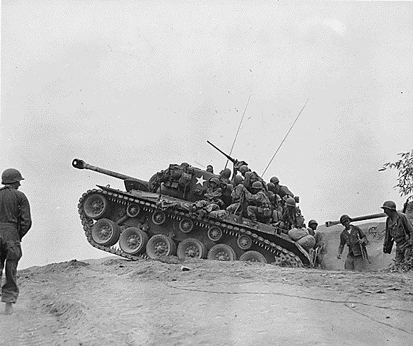 Soldiers of US 9th Infantry Regiment on a M26 Pershing tank, near the Nakdong River, Korea, 3 Sep 1950