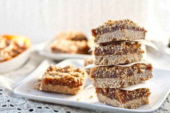 No bake Vegan date squares, replace oats with mac nuts or almond meal. Crust may need more dates to keep from crumbling later.  Used dates for half the bars and figs for the other.  These were really good.
