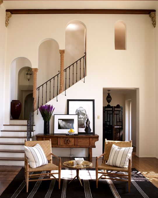 Eclectic Entryway.  Love the chairs, console, artwork, area rug....it all gives so much character to the Entryway/Foyer. by Martyn Lawrence-Bullard Design