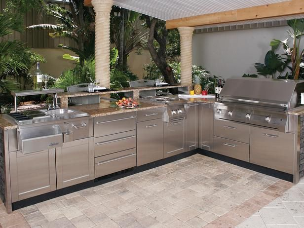 Love the roof (where's the ceiling fan for Texas summers), the stainless steel appliances, and counter top work spaces: Danver Stainless Steel Outdoor Kitchen