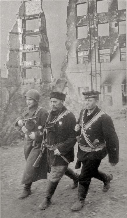 """""""Defenders of Stalingrad"""", 1942: Soldier, Sailor and Civilian defend the city; probably posed, but evocative nonetheless."""