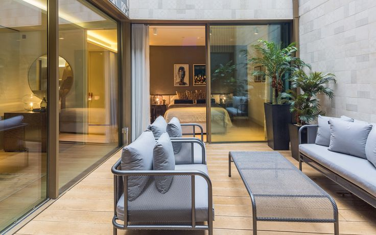 A haven within London's edgy Soho, we designed the private outdoor terrace of this funky apartment to offer a little oasis of luxury, injecting vibrant greenery into the urban envirnment with Mediterranean-inspired plants and seating.