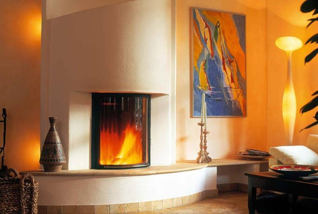 Something with a brick/stone/masonry/concrete surround is good because it holds the heat longer and releases it after the fire has gone out: thermal mass!  I also like the potential to sit on the hearth of this one.