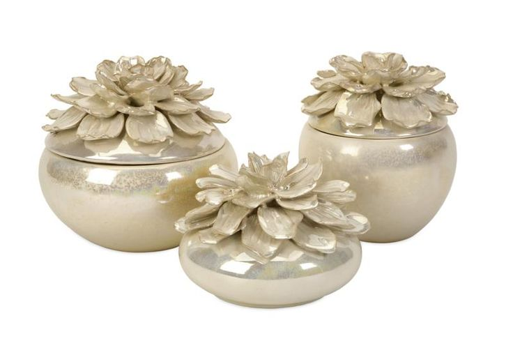 The hand-sculpted Blair Floral Boxes, are a beautiful way to sort jewelry or other small items. With their lustrous glaze and delicate petals, they are perfect for displaying in a bedroom, sewing room or garden room. Set of 3.