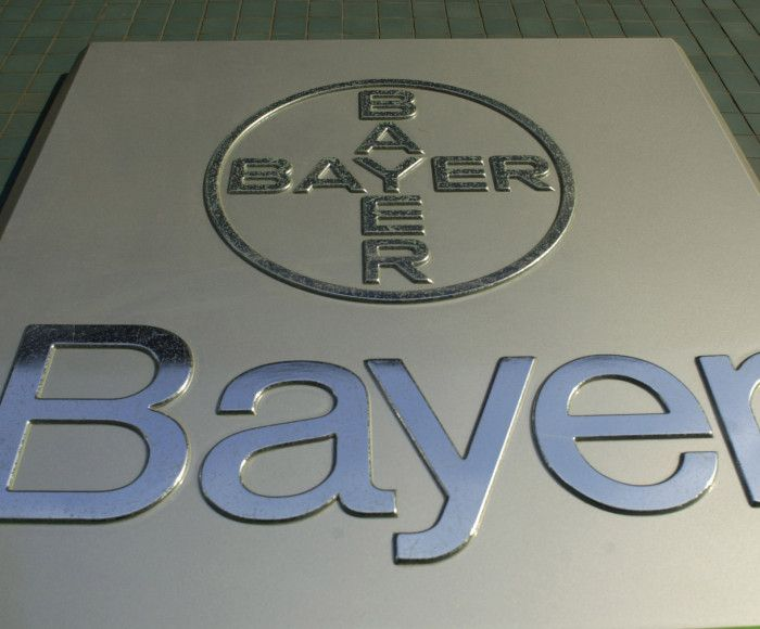 A Bayer logo is seen on their headquarters in Leverkusen, Germany on November 12, 2002.  Bayer AG posted a third-quarter profit on the sale of its flavor and fragrance unit.  Europe's third-largest chemical maker also said it's no longer insisting on a majority role in a pharmaceutical partnership.   Photographer:  Paul O'Driscoll/Bloomberg News.   Photo by Paul OÕDriscoll