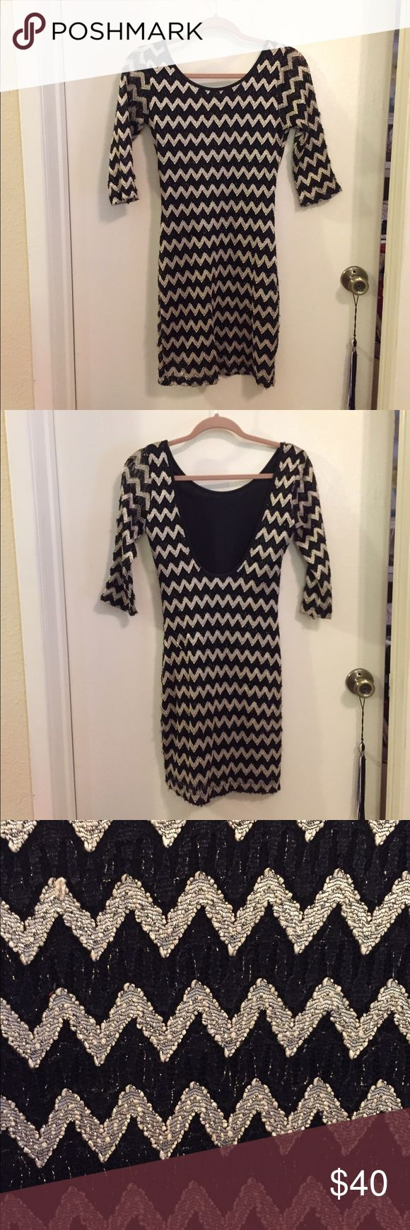 Gold foil, chevron pattern bodycon dress. Gold foil, chevron pattern bodycon dress with sheer sleeves, so the sleeves are partly see through. Stretchy material. Dresses