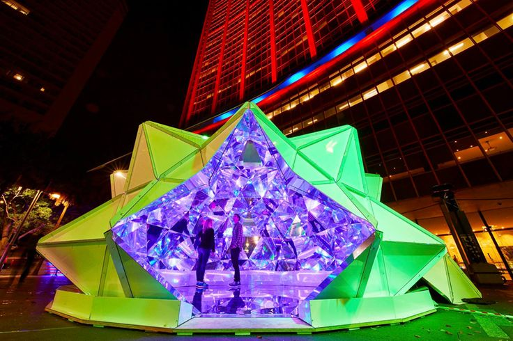 kaleidoscopic origami dome bathes visitors in luminous reflections