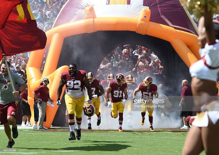 Washington Redskins nose tackle Chris Baker (92) runs out of the tunnel prior to action against the Miami Dolphins at FedEx field on September 13, 2015 in Landover, MD.