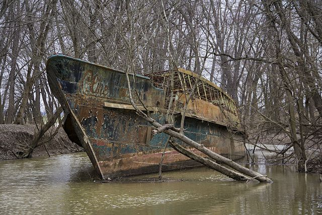 Ghost ship in a creek near Cincinnati off the Ohio river. The Circle Line V was launched on April 12, 1902 as the Celt and had a long and interesting history before being grounded in the creek off of its final owner's property in 1986. It rots there to this day.