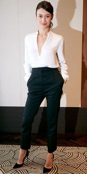Sleek work attire. Black trousers. Black pumps. White plunging v-neck blouse