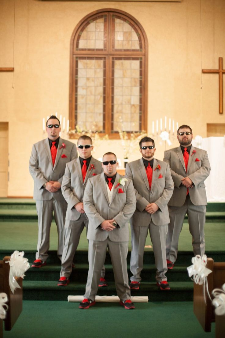 Red and gray tuxes  Our groomsmen were wearing our theme colors Ohio state Scarlet and gray