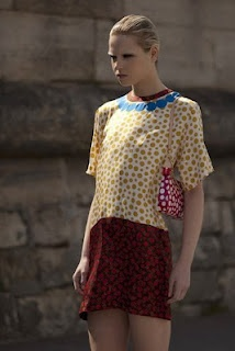 it looks vintage, but it s not..check out the new collection Louis Vuitton