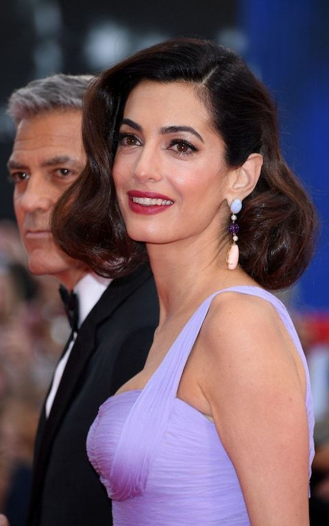 Amal Clooney wearing lavender jade, purple sapphire, coral and diamond earrings by Lorraine Schwartz at the premiere of Suburbicon