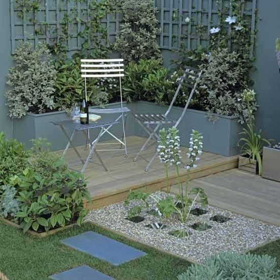 Contemporary garden Designer Alan Smith presented this pretty garden at the Hampton Court Palace Flower Show. The wooden deck has just enough room for the metal table and chairs, and plants in a raised bed provide a great eye-level backdrop. The trellis, painted the same colour as the wall behind, is an original feature, while the gravel patch is turned into focal point with a series of mirrored tiles set into it. The tranquil look is finished with calm shades of green, silver and white.