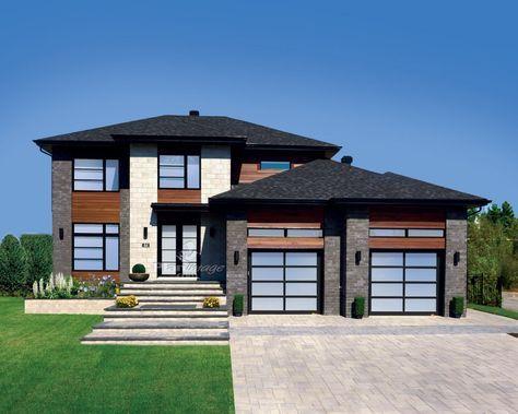 Cette maison à étage au look contemporain offre une surface habitable de 2 145 pieds carrés et mesure 52 pieds 10 pouces de largeur sur 44 pieds de profondeur. Elle possède un garage double de 613 pieds carrés. Le rez-de-chaussée fait 1 028 pieds carrés et comprend un vestibule fermé, une salle d'eau avec espace pour la laveuse et la sécheuse, une salle à manger, ainsi qu'une aire ouverte à l'arrière de la maison qui comprend un salon donnant sur la cour arrière avec un f...