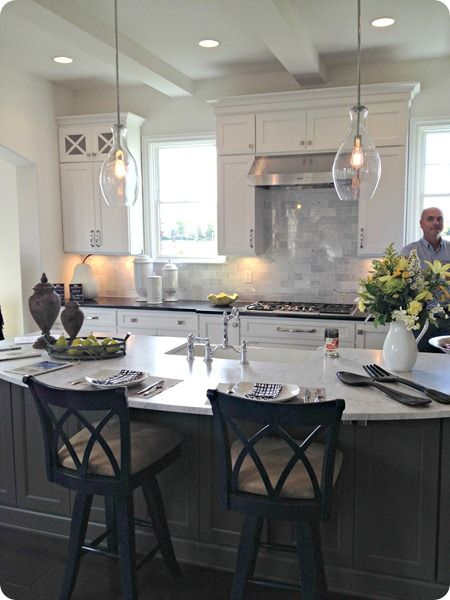 love the gray island with the white cabinets and the light fixture!