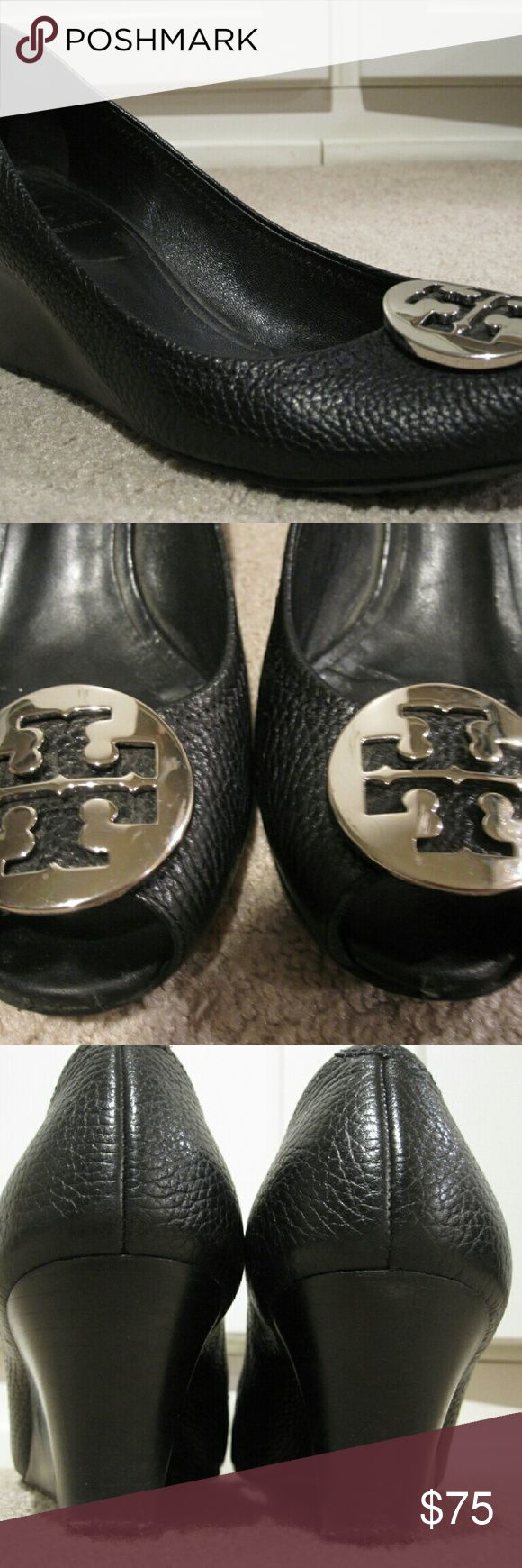 """Tory Burch Sally 2 Black Peep Toe Wedge Size 8 This is a pair of Tory Burch Sally 2 peep toe wedge heels in size 8. They are made of black pebbled leather and have a gleaming silver emblem on the front. They have a 2.5"""" heel making them great for work. These have been worn and show signs of wear on the soles. The heels are going to need new tips and the insoles are starting to come up slightly on the front. However these are great quality and have a lot of life remaining in them. Tory Burch…"""