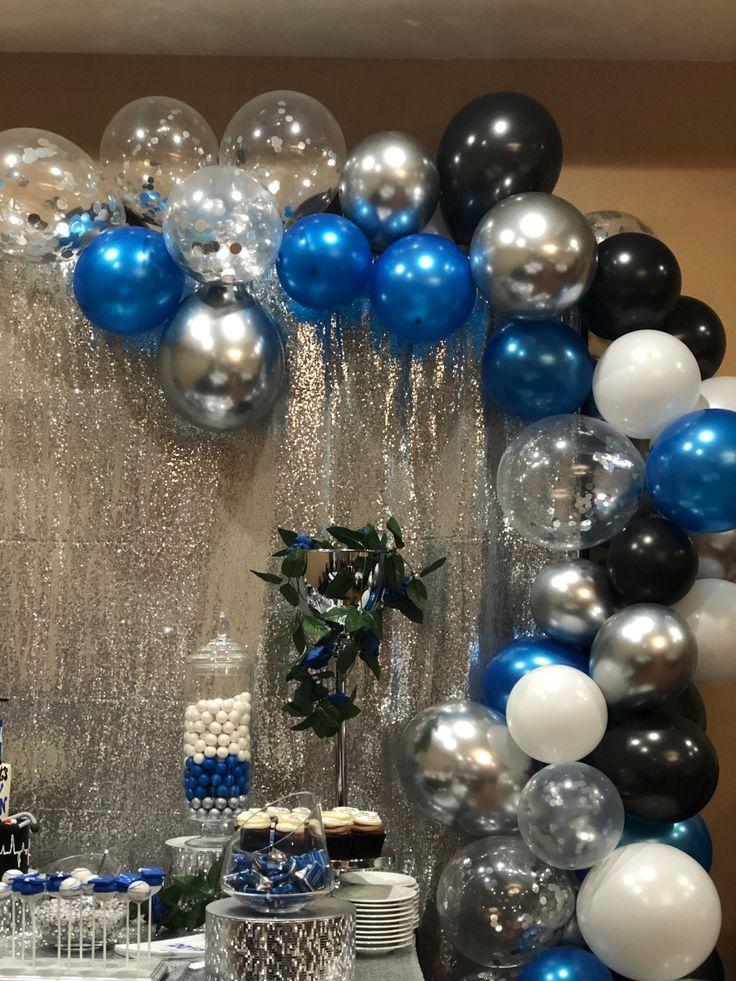 Graduation balloon garland. Dessert table royal blue, silver, and black.