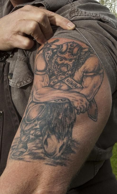 On his left arm, Mike Holmes sports a Viking on bended knee, the symbol of a strong warrior. From DIYnetwork.com