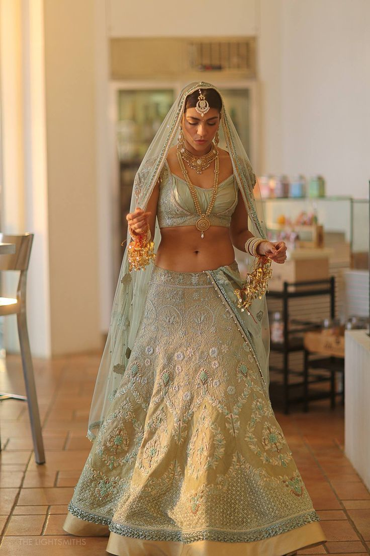 Icy seafoam and gold lehenga, Photography by Lightsmiths, Lehenga by Tahiliani