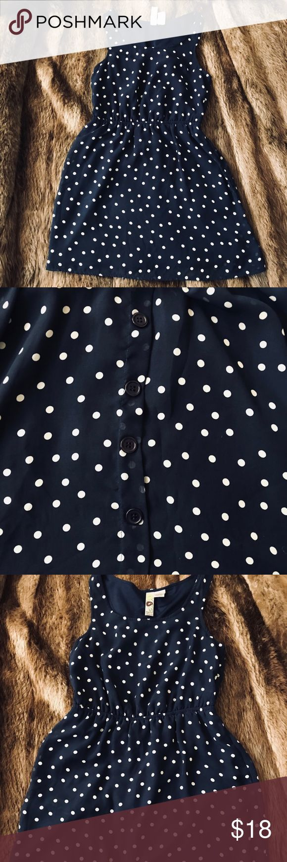 Navy Blue Polka Dot Mini Dress Really cute and comfortable. Navy blue with white polka dots, fake button (large buttons) up back and scoop neck. Great for your neck bbq ! Looks fabulous with a pear of wedges and a sun hat ! Dresses Mini