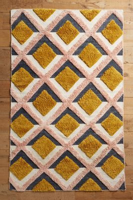 Anthropologie Hand-Tufted Trellis Rug https://www.anthropologie.com/shop/hand-tufted-trellis-rug?cm_mmc=userselection-_-product-_-share-_-39395728