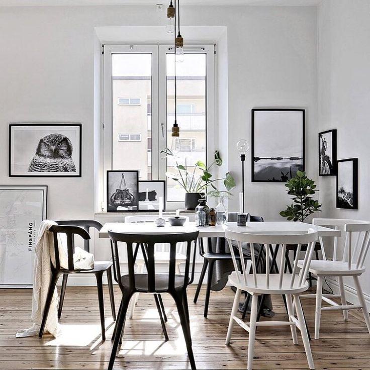 Une salle à manger scandinave noire et blanche