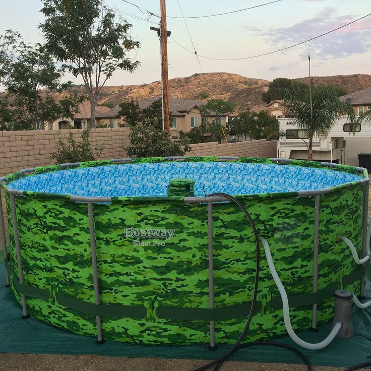 Increasing property values in my neighborhood with a camo green above-ground pool complete with floating cooler/drink holder. #sorrynotsorryneighbors