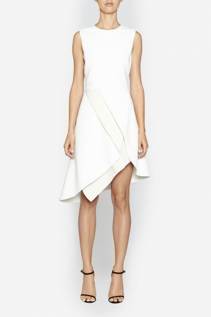 Camilla and Marc | GEO DRESS  US$547.31 Multi-layered cocktail dress designed in a white twill with a contrasting textured honeycomb jacquard. Created with a simple, fitted bodice and balanced with an asymmetrical A-line skirt. Includes an invisible zipper fastening at the centre back of the bodice.
