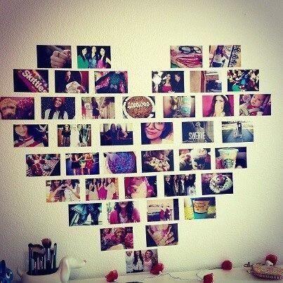 Collage de fotos en forma de corazón hecho directamente en la pared