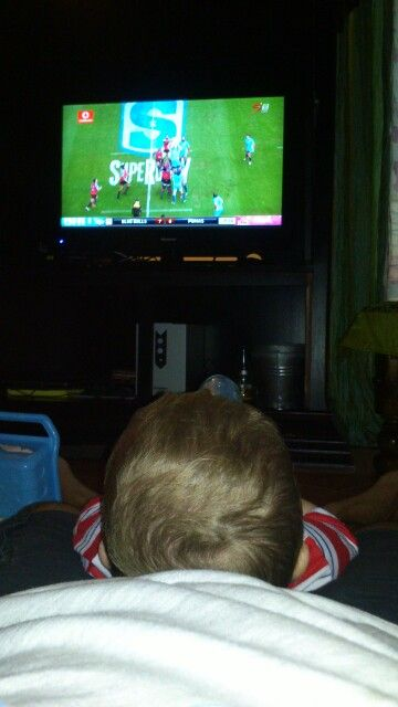 My son I watching rugby together