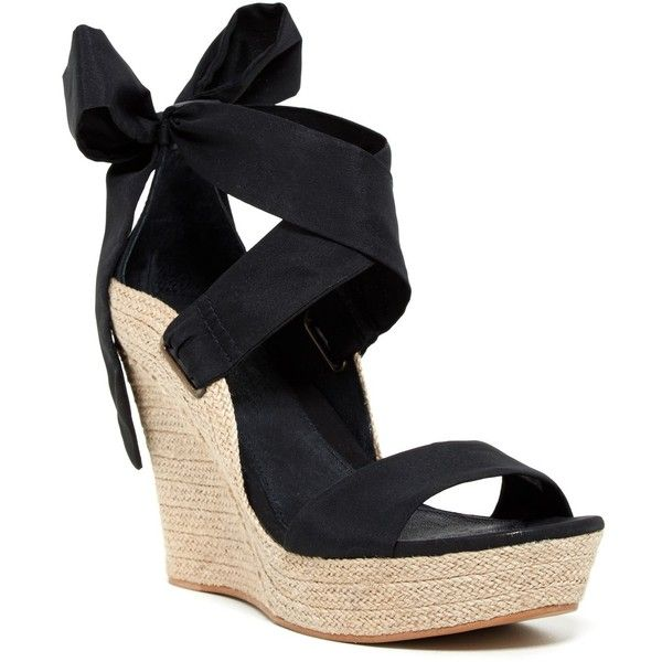 "Sizing: True to size.;Open toe;Crisscross strap with back bow detail;Wedge heel;Approx.  5"""" heel, 1"""" platform;Imported"