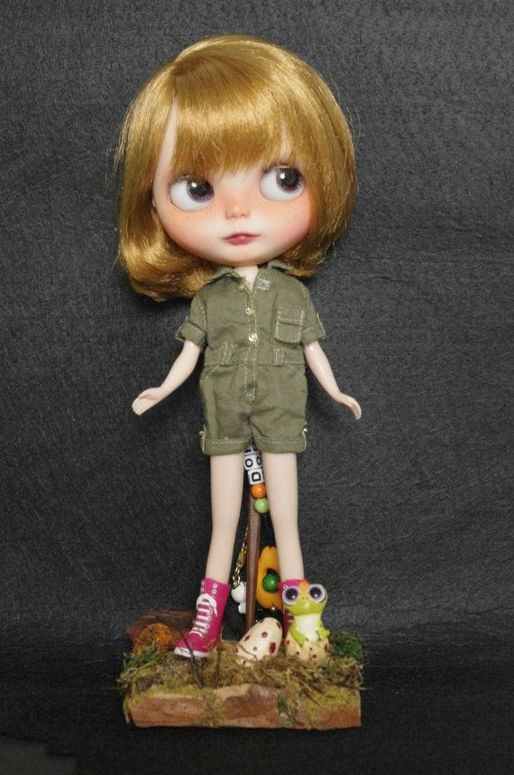 Blythe size stand.  https://www.etsy.com/listing/216863674/stand-little-dino-for-blythe-dal-pullip?ref=shop_home_active_24
