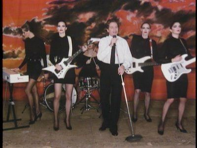 "These iconic female non-players backup Robert Palmer on his ""Addicted To Love"" video."
