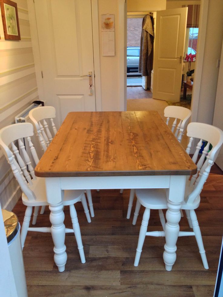 Sand back the table top, finish it with a hard wax, and paint the legs and chairs?