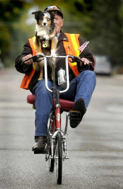 Despite the change in the weather, Bill Evans and his dog, Precious, found a break in the rain to pedal across town on an October afternoon. KURT WILSON/Missoulian: Missoula Pets, Puppies Dogs, Montana Style, Bill Evans, October Afternoon, Missoulian Photography, Kurt Wilson Missoulian