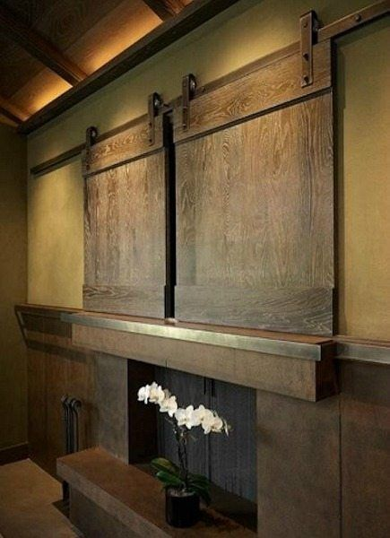 Neat concept on the barn door to hide the flatscreen tv. Love that too! TV is probably recessed into the wall a bit. Interior Barn Doors
