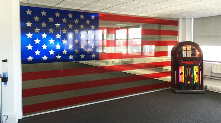 USA flag window tinting. This tinted film applied to this office partition glass changed the entire atmosphere of this office. Created by Space3.co.uk