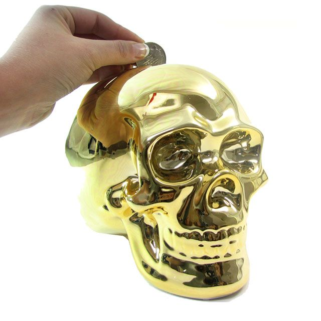 Putting coins in the Gold Skull Money Box