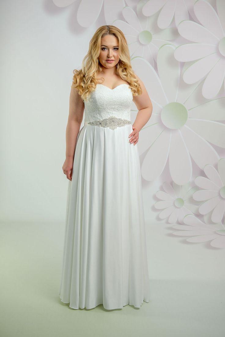 Krásne svadobné šaty s čipkovaným korzetom a padavou sukňou