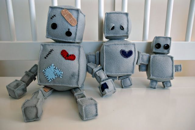 Felt crafted robot family.  I'll have time to make these awesome bots for grandkids one day I hope!