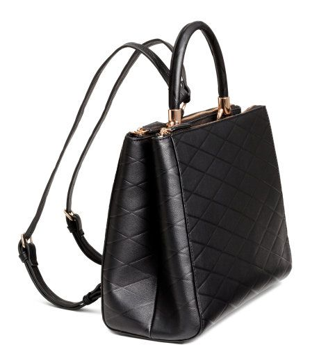 Check this out! Backpack-style handbag in grained imitation leather with narrow, adjustable shoulder straps and a handle at top. Two large compartments with zip and concealed center compartment. Lined. Size 4 3/4 x 9 x 11 1/2 in. - Visit hm.com to see more.