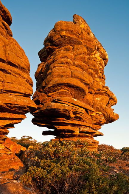 Grampians National Park, Victoria Two isolated rock stacks perched high on Mount William catch the last light of day. http://www.paulsinclairphotography.com.au/gallery_488844.html#photos_id=9272515 More